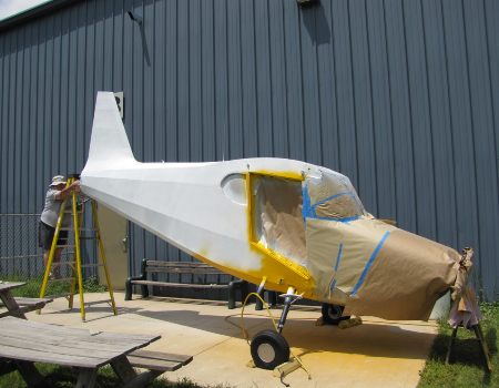 Stinson: Final painting of fuselage
